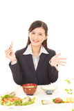 Woman who enjoys Japanese food Stock Images