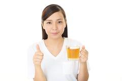 Woman who enjoys the tea break Stock Image