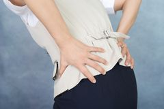Woman who has a back pain royalty free stock photo