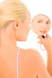 Woman who looks in the mirror Royalty Free Stock Photography