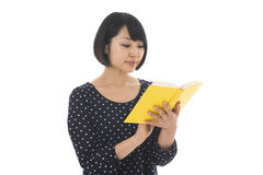 Woman who reads a book Stock Photography