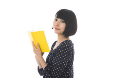 Woman who reads a book Stock Images