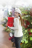 Woman who runs away with her christmas gift Stock Photography