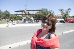 Woman who smiles on her holidays, in the background the sculptur. E of a seaplane, Lisbon, Portugal Stock Photos
