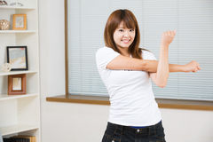 The woman who stretches exercise Royalty Free Stock Photo