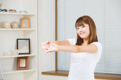 The woman who stretches exercise Royalty Free Stock Image