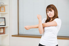 The woman who stretches exercise Stock Image
