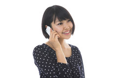 Woman who talks on the telephone Royalty Free Stock Photography