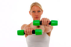 Woman who trains with dumbbells in hand Royalty Free Stock Photography