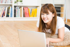 The woman who uses the computer. The Young woman who uses the computer in a room Stock Photo