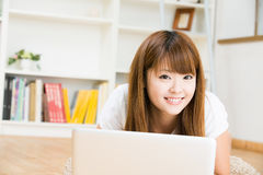 The woman who uses the computer. The Young woman who uses the computer in a room Stock Image