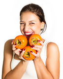 Woman who very fond persimmon! Stock Photo
