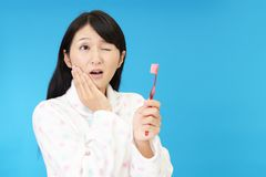 Woman with a toothbrush royalty free stock photography