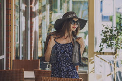 Woman in a wicker hat in summer cafe Stock Photos