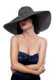 Woman in a wide brim hat. Elegant female portrait wearing wide brim hat over eyes isolated on white stock photos