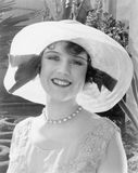 Woman in a wide brimmed hat smiling. (All persons depicted are no longer living and no estate exists. Supplier grants that there will be no model release issues royalty free stock images