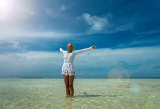 Woman with wide open arms standing Stock Image