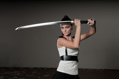 Woman Wielding Ceremonial Sword Royalty Free Stock Photography