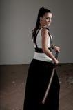 Woman Wielding katana Stock Image