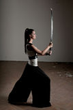 Woman Wielding katana Stock Photo