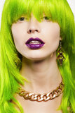 Woman in a wig. Young woman in a bright green wig, indoor Royalty Free Stock Images