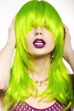 Woman in a wig. Young woman in a bright green wig, indoor Stock Photography