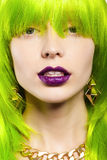 Woman in a wig. Young woman in a bright green wig, indoor Stock Photos