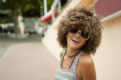 Woman in a wig of curly hair Stock Images