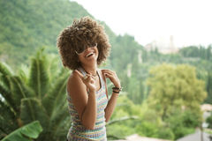 Woman in a wig of curly hair royalty free stock image