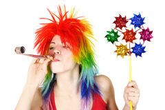 Woman in wig with party blower and pinwheel stock photos