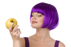 Woman in wig with yellow apple Stock Photos