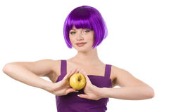 Woman in wig with yellow apple Royalty Free Stock Photos