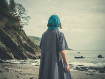 Woman wih headscarf on beach Royalty Free Stock Photography