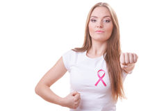 Woman wih pink ribbon on chest punching boxing Stock Photography