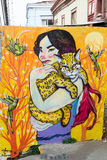 Woman and wild cat in nature. VALPARAISO - NOVEMBER 07: Street art on the wall of a house in the districts of the protected UNESCO World Heritage Site of royalty free stock image