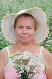 The woman and wild flowers. Royalty Free Stock Image