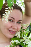 Woman in wild flowers Royalty Free Stock Image