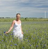 Woman in wild flowers field Royalty Free Stock Image