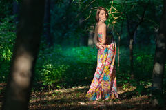 Woman in wild green forest stock photography