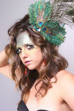 Woman with Wild Makeup with a Peacock Feather in her Hair Stock Images