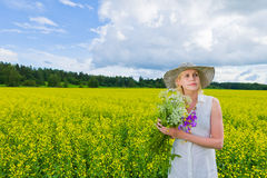 Woman and wildflowers Stock Photo