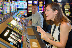 Woman willing on arcade game. Woman willing on an arcade game Royalty Free Stock Image