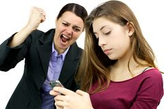 Woman willing to destroy cell phone of daughter. Unhappy women about daughter addicted to cell phone stock photos