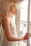 Woman at Window Royalty Free Stock Photo