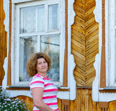 Woman at the window of  country house Royalty Free Stock Photos