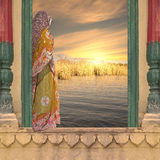 Woman on the window. Indian woman on the window in the sunset Stock Image