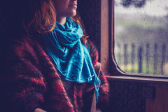 Woman by window in old train carriage Royalty Free Stock Photo