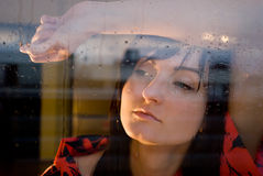 Woman window rain. Sad portrait spring autumn home Royalty Free Stock Photography