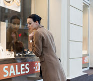 Woman at window shop jewellery Royalty Free Stock Photography
