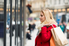 Woman window shopping in centre of the city. Winter Royalty Free Stock Photos